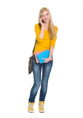 blabber: Full length portrait of happy student girl speaking mobile