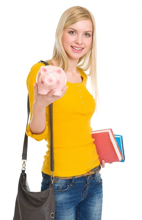 youthfulness: Happy student girl showing piggy bank