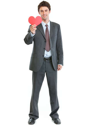 Full length portrait of modern man in business suit with paper heart Stock Photo - 17539068