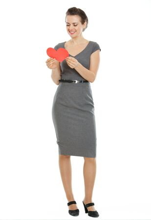 Full length portrait of modern woman reading heart shaped postcard Stock Photo - 17539059