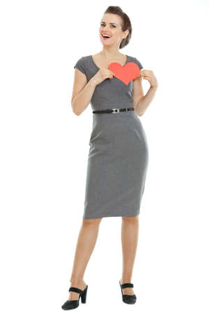 Full length portrait of modern woman holding heart shaped postcard Stock Photo - 17539069