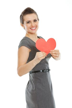 Smiling young woman showing heart shaped postcard Stock Photo - 17539060