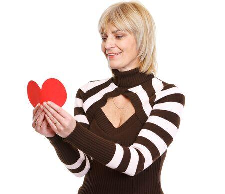 Happy mature woman reading heart shaped postcard Stock Photo - 17539070