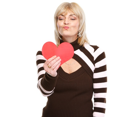 Happy mature woman enjoying heart shaped postcard Stock Photo - 17539067