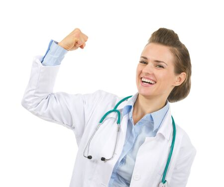 Happy medical doctor woman showing biceps Stock Photo - 17563341