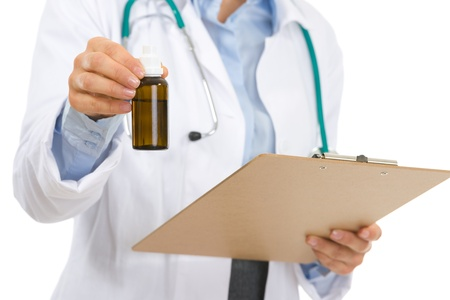 medecine: Closeup on medical doctor woman with clipboard and medecine bottle