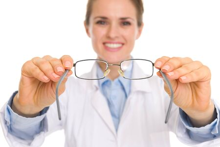 Closeup on medical doctor woman giving eye glasses Stock Photo - 17563349
