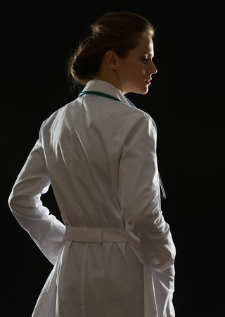 Silhouette of medical doctor woman looking on copy space Stock Photo - 17563287