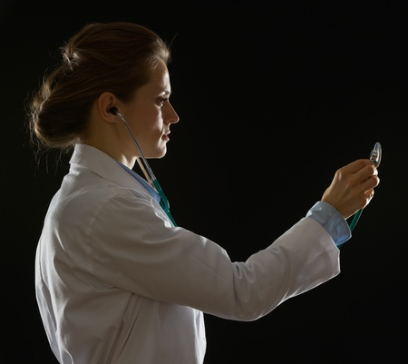 Silhouette of medical doctor woman using stethoscope photo