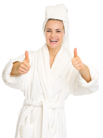 Smiling young woman in bathrobe showing thumbs up Stock Photo - 17668929