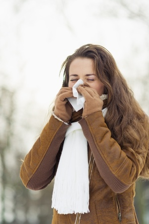 Woman blowing nose in winter outdoors Stock Photo - 17797386