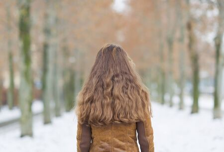 Young woman in winter park. rear view Stock Photo - 17797429