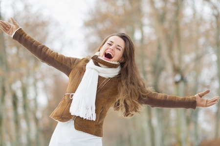 Portrait of happy young woman in winter outdoors Stock Photo - 17797416