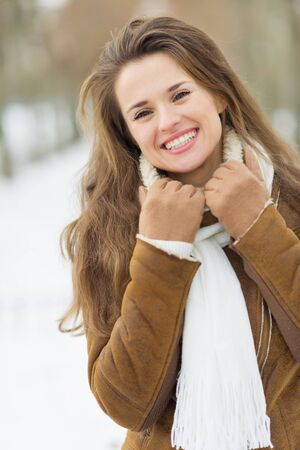 Portrait of smiling young woman in winter outdoors Stock Photo - 17797424