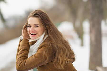 Portrait of happy young woman in winter outdoors Stock Photo - 17797427