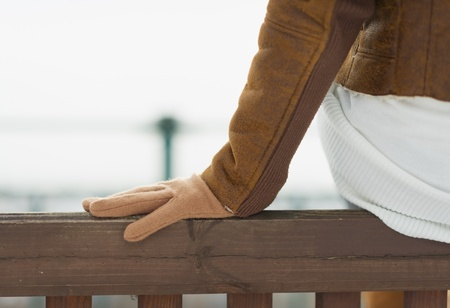Closeup on hand on bench in winter outdoors Stock Photo - 17797390