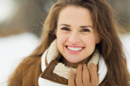 Portrait of smiling young woman in winter outdoors Stock Photo - 17797422