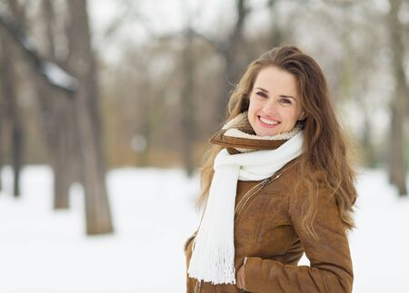 Portrait of smiling young woman in winter park Stock Photo - 17797375