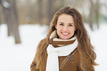Portrait of happy young woman in winter park Stock Photo - 17797419