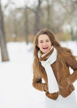 Portrait of happy young woman in winter park Stock Photo - 17797415