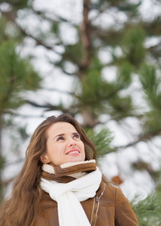 Happy young woman looking up on copy space in winter park Stock Photo - 17797388