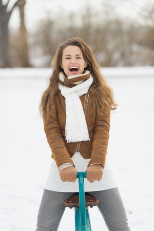 Happy young woman having fun in winter park Stock Photo - 17797383