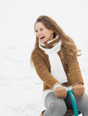 Happy young woman having fun in winter outdoors photo