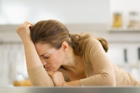 Stressed young housewife in kitchen Stock Photo - 17800147
