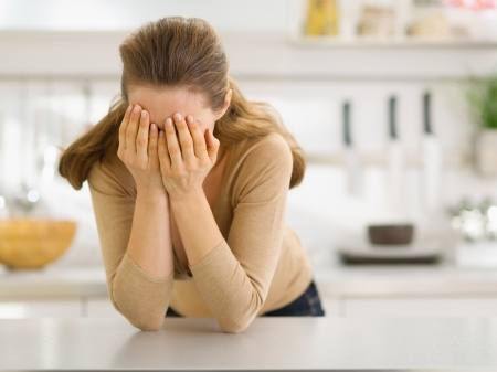 Stressed young woman in kitchen Stock Photo - 17800093