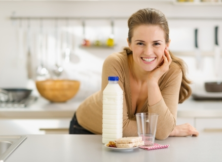Portrait of smiling young woman with snacks Stock Photo