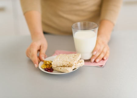Closeup on young woman with snacks Stock Photo - 17800084