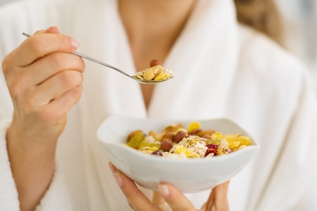 Closeup on woman in bathrobe eating healthy breakfast Stock Photo - 17800083
