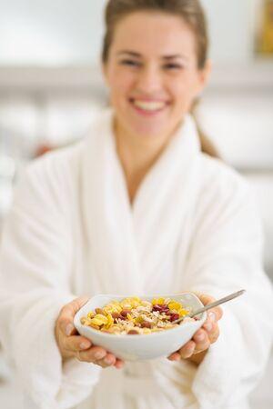Closeup on healthy breakfast in hands of happy woman in bathrobe Stock Photo - 17800074