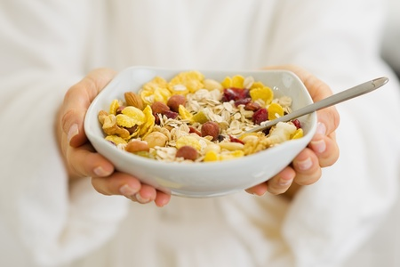 Closeup on healthy breakfast in woman hands Stock Photo - 17800061