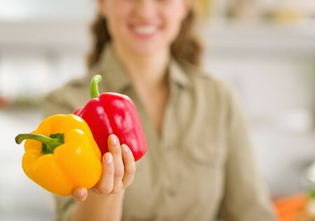 Closeup on fresh bell peppers in hand of young woman Stock Photo - 17800085