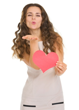 Smiling young woman showing valentine's day cards and blowing kiss Stock Photo - 17890625