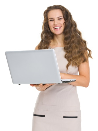 Smiling young woman holding laptop Stock Photo - 17890605