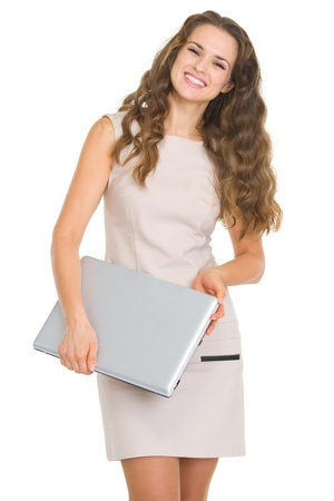 Portrait of smiling young woman with laptop Stock Photo - 17890622