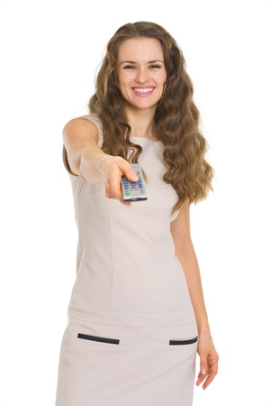 Happy young woman switching channels with tv remote control Stock Photo - 17890624