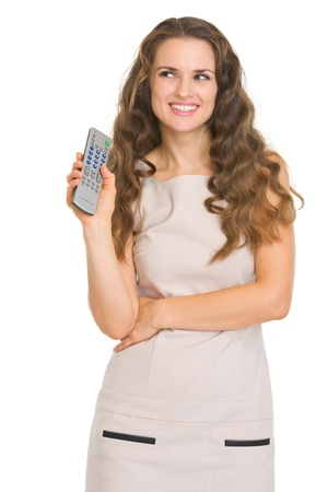 tv remote: Happy young woman with tv remote control looking on copy space Stock Photo