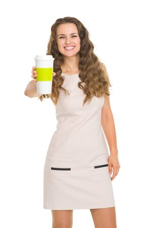 Smiling young woman giving coffee cup Stock Photo - 17890565