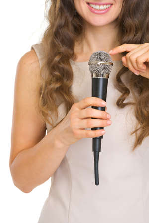Closeup on young woman tapping on microphone to check sound Stock Photo - 17890632