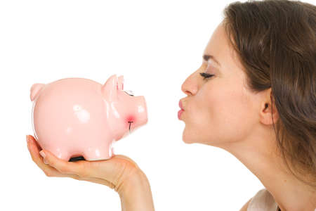 Closeup on young woman kissing piggy bank Stock Photo - 17890590