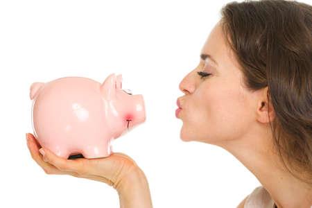 Closeup on young woman kissing piggy bank Stock Photo - 17890590