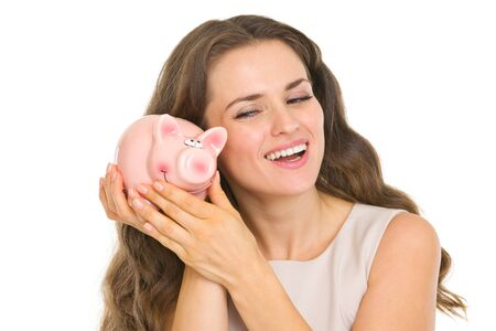 Happy young woman shaking piggy bank Stock Photo - 17890626