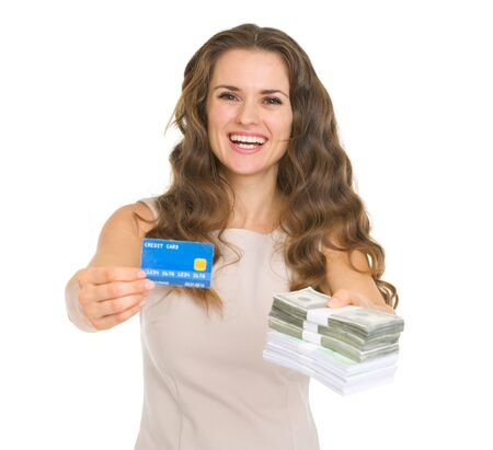 Happy young woman showing credit card and money packs Stock Photo - 17890561