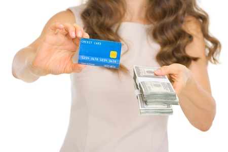money packs: Closeup on woman showing credit card and money packs Stock Photo
