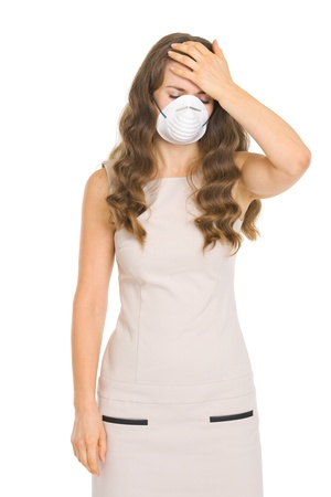 Young woman in mask checking forehead temperature Stock Photo - 17890608