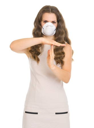 Young woman in mask showing stop gesture Stock Photo - 17890567