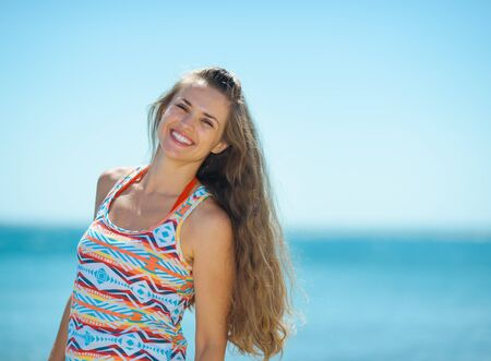 Portrait of smiling young woman on beach Stock Photo - 17934014